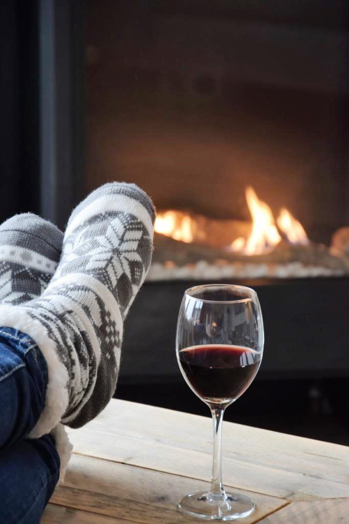 Hygge = cozy socks, red wine and a fireplace